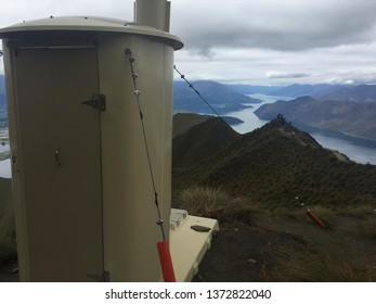 Room with a view. Toilet block on a hiking trail high up a mountain.  View over Lake Wanaka from Roys Peak tramp in New Zealand.  When nature calls