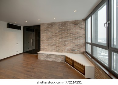 The room with walls from a red decorative brick with glass black doors