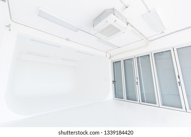 The room with white painted and white floor used for a photo studio, right hand side has a window, is a room suitable for professional photographers and amateurs, Cyclorama wall.