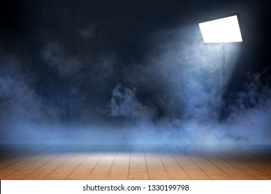 Room with wooden floor and smoke with light from spotlights against dark wall background