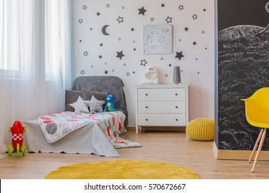 Room for young astronaut with bed and toys
