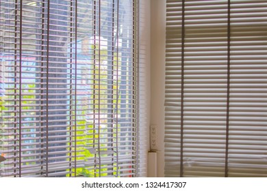 Rooms with blinds, shade, roller, shutter protected sunlight background and glass room.