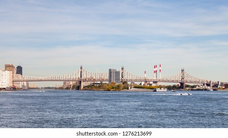 Roosevelt Island.  Roosevelt Island on the East River, New York is pictured.  Queensboro Bridge passing over the island can be seen connecting Queens and Manhattan.