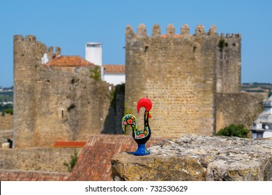 Rooster of Barcelos (Galo de Barcelos) on a medieval wall in Obidos. Portugal