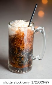 Root beer float with vanilla ice cream. Cocktails. Alcoholic Drinks with gin, vodka, rum or whiskey mixed with soda water, fruit juices, garnished w/ limes & cherries. Classic American bar drinks.