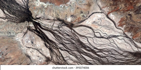 the root of life,allegory, tribute to Pollock, abstract photography of the deserts of Australia from the air,aerial view, abstract expressionism, contemporary photographic art, abstract naturalism,