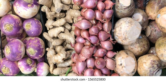Root vegetable background from a variety of fresh produce