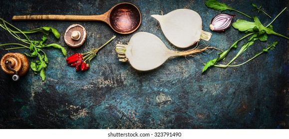 Root vegetables with wooden spoon and fresh ingredients for  healthily cooking on rustic background, top view, banner. Vegan or diet food concept