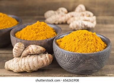 Roots and turmeric powder (Curcuma longa)