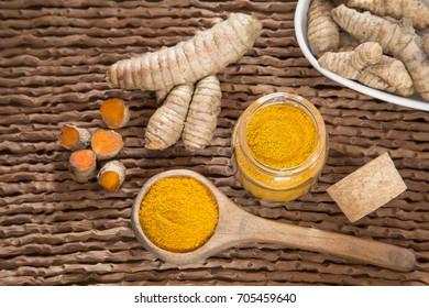 Roots and turmeric powder - Curcuma longa