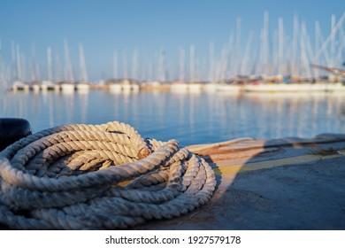 Rop on the wharf of marina harbor.