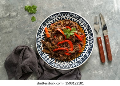 Ropa Vieja with Fried Plantains. carne desmechada, carne desmenuzada, carne mechada  tipical food of Chile, Colombia, Costa Rica, Cuba, Spain, Honduras, Mexico, Puerto Rico.