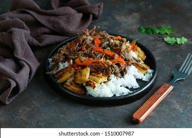 Ropa Vieja with Fried Plantains and rice. carne desmechada, carne desmenuzada, carne mechada  tipical food of Chile, Colombia, Costa Rica, Cuba, Spain, Honduras, Mexico