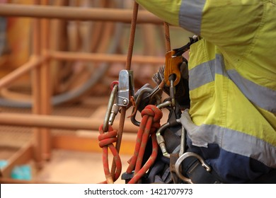 Rope access abseiler worker working at height abseiling hanging on fall safety body harness chest safety secondary ascender