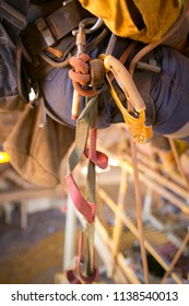 Rope access equipment descender leg loop hanging on the side of inspector abseiler safety harness loop at construction site Perth, Australia