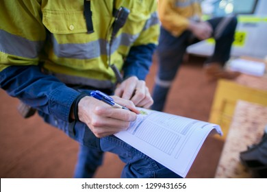 Rope access miner supervisor written checking inspecting issuer the paper work permit prior to work on construction mine site Perth, Australia
