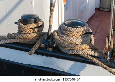 Rope at bollards on a ship railing
