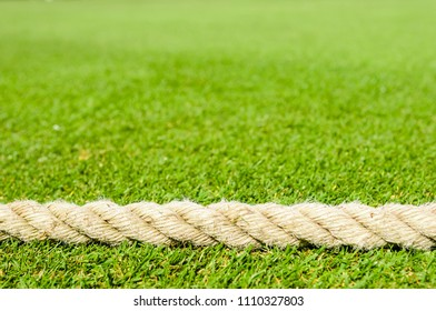 Rope at the boundary of a cricket pitch
