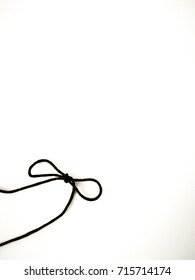 Rope bow black colour on white isolated background.