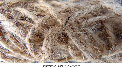 Rope braided in a pigtail close-up. Twine which is useful for agriculture.
