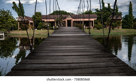 rope bridge hanging over a lake