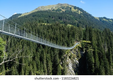 rope bridge over a deep canyon, tirol, austria
