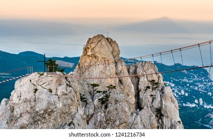 Rope bridges and a cross at Ai-Petri, a peak in the Crimean Mountains
