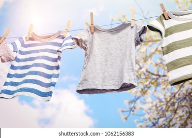 Rope with clean clothes outdoors on laundry day