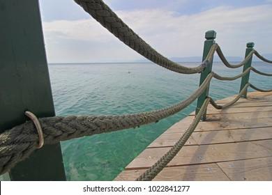 Rope fence  and the Aegean sea sea
