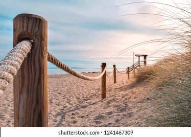 Rope fences protecting dune system on Es Cavallet Beach, Ibiza (Spain).