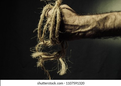rope in the hands of a dark background