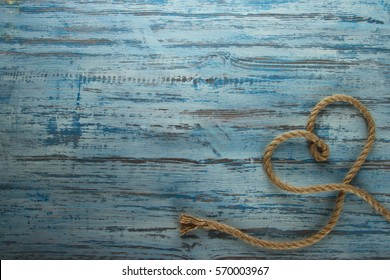rope heart on a wooden background