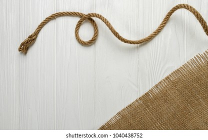 Rope and hessian fabric on wooden table