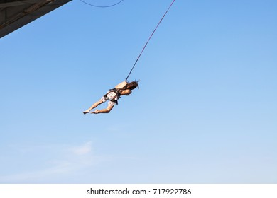 Rope Jumping: people in flight from a height. Jump from height.