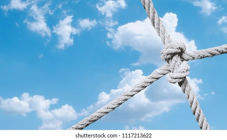 rope knot of net against blue sky background