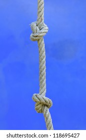 Rope with knot on blue background