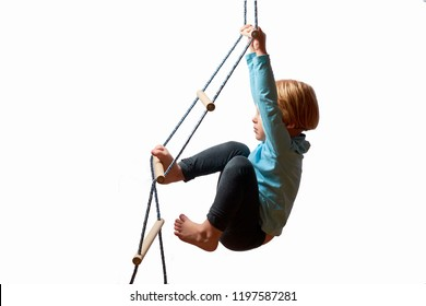 rope ladder child climbs and swings .Way up