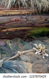 Rope lying on the old fishing nets and trawls in the graveyard of ships