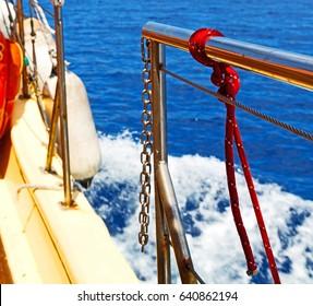 rope    and metal in the blue skay aocean mediterranean sea