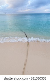 Rope on the beach and blue ocean