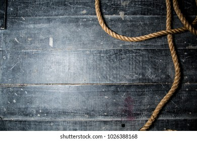 rope on the floor of black boards