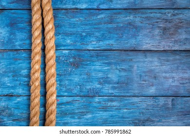 Rope on old wooden deep blue  board background