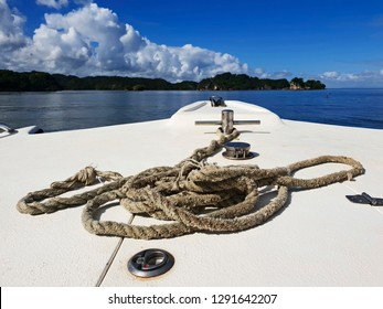 rope on the top of boat and samana island coastline on background view in dominican republic