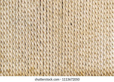 Rope stacking in vertical pattern. String texture abstract background