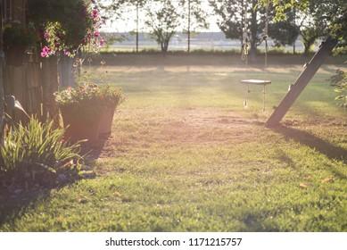 rope swing in bright morning sunlight - overexposed for effect
