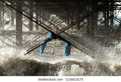 Rope tangled on the ironwork under Brighton Pier, Sussex during a winter storm