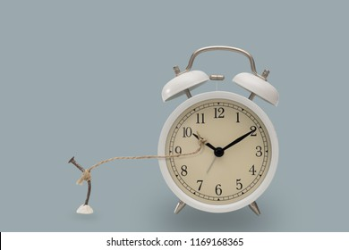 Rope tie with nails and alarm clocks , Time concept.