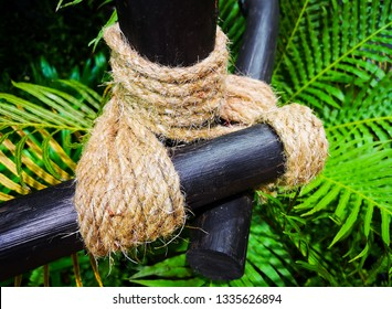 Rope tied with a wooden fence in the garden.