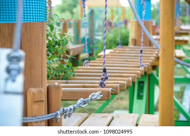 Rope town. Active family vacation in the open air. Elements of a rope town in the park.