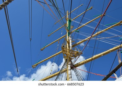Ropes on the mast of sailboat on a sunny day